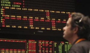 A trader looks at an order board in the S&P 500 pit at the CBOT in Chcago