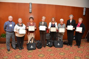 L to R: Larry and Ruth Willy, Lake County; Patty Baker, Wells County; Anne Smith, Wayne County; Michelle Stanger, Monroe County; Marlene Fudge, Rush County; Erna Lloyd, Spencer County; and Karen King, Clark County.  Volunteer of the Year Kerry Dull was unable to attend the conference.