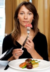 woman-eating-meat